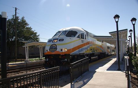 A SunRail commuter train pulls out the station, whisking people to work in Orlando