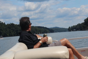 man on boat with beer